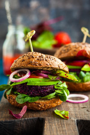 40527968 - veggie beet and quinoa burger with avocado